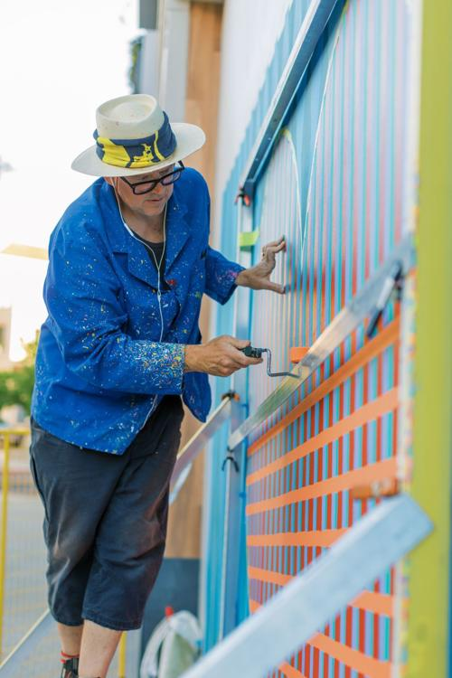 Artist Mikey Kelley painting a mural